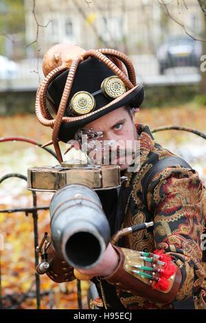 Haworth, UK. 19th Nov, 2016. A Steampunk clothed man pointing a gun towards the photographer, Haworth, 19th November - Stock Photo