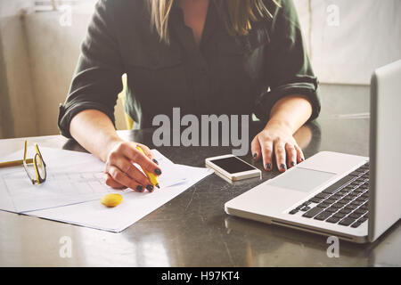Architect woman sketching in her office - Stock Photo
