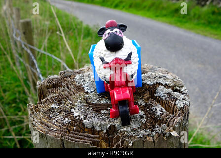 Shaun the Sheep Aardman Cartoon Character Toy Figure On a Gatepost, UK - Stock Photo