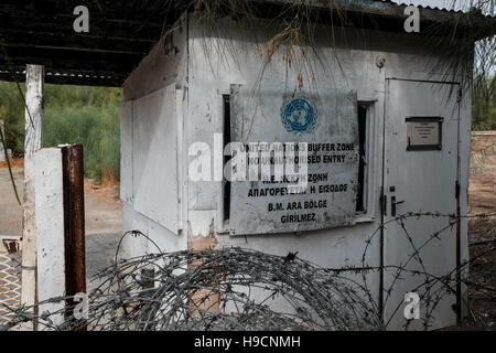 An abandoned United Nations post marks the start of the buffer zone between Greek Cypriot and Turkish Cypriot areas - Stock Photo
