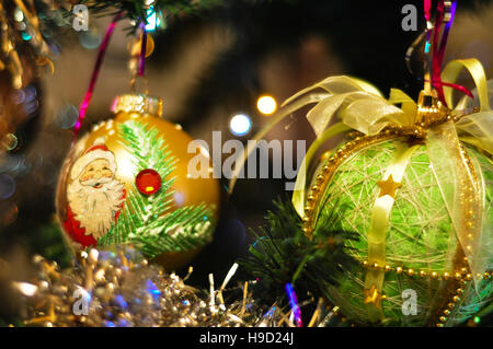 Decorated Christmas tree on blurred, sparkling and fairy background, New Year - Stock Photo