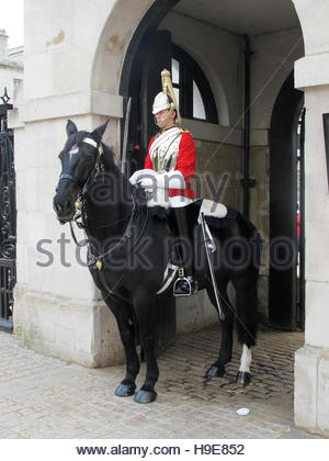 LONDON, UK - OCTOBER 2014: The Queen´s Household Cavalry in traditional uniform in St James's Park in London. - Stock Photo
