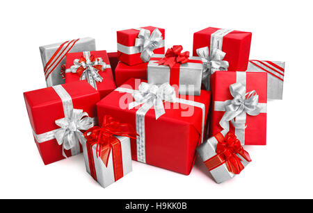 Fashionable pile of red and silver gift boxes with ornate bows, studio isolated on white background - Stock Photo