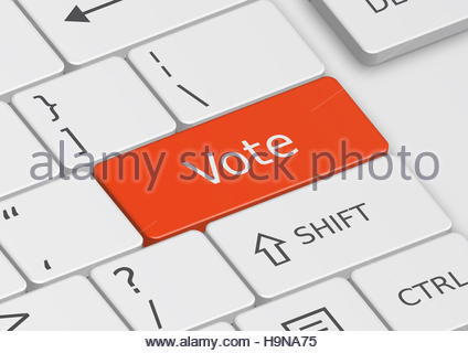 The word Vote written on a red key from the keyboard - Stock Photo