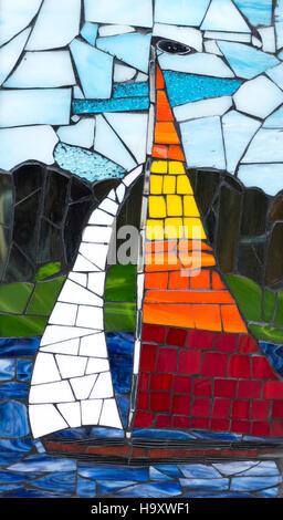 Colorful ceramic sailboat art on the sidewalk of Battle Lake Minnesota MN USA - Stock Photo