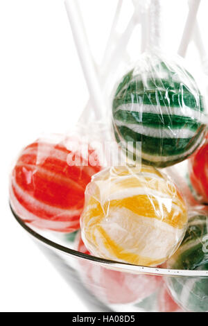 Striped lollies in a glass - Stock Photo