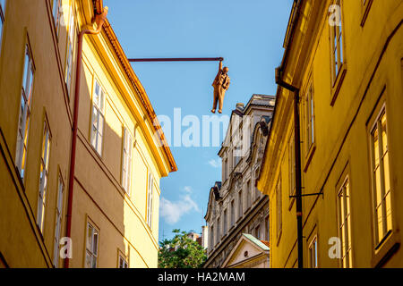 Man hanging out sculpture - Stock Photo