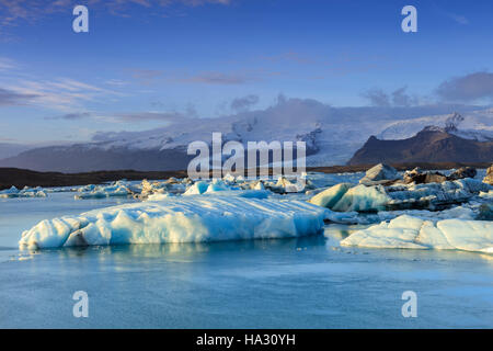 Icebergs in Jokulsarlon, a glacial lake in southeast Iceland, on the edge of Vatnajokull National Park - Stock Photo