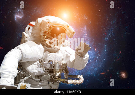 Astronaut in outer space. - Stock Photo