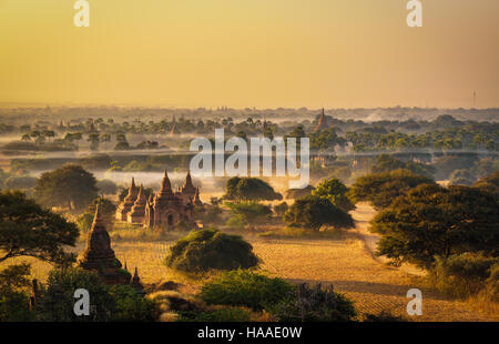 Sunrise above Bagan in Myanmar. Bagan is an ancient city with thousands of historic buddhist temples and stupas. - Stock Photo