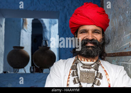 Man from Rajasthan dressed in traditional clothes, Jodhpur, Rajasthan, India - Stock Photo