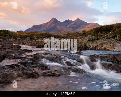 First light hits the top of Sgurr nan Gillean on the isle of skye taken from the river sligachan - Stock Photo