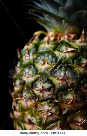 Large ripe pineapple isolated on black background - Stock Photo