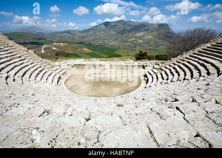ancient Greek stone theatre ruins view on scenic panorama background, Segesta, Sicily, Italy - Stock Photo
