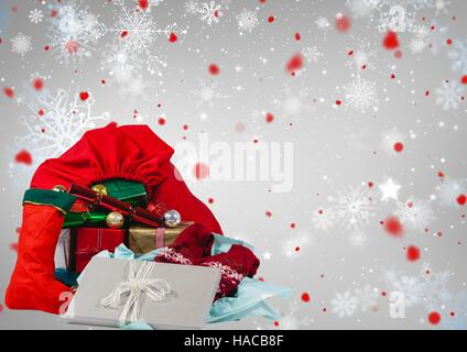 Santa sack full of christmas gifts - Stock Photo