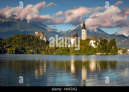 St Mary's Church of the Assumption on Bled Island in Lake Bled with Bled Castle beyond, Bled, Upper Carniola, Slovenia - Stock Photo