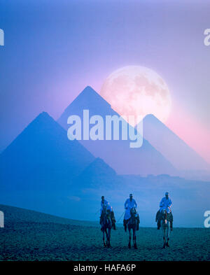 Full moon rising behind the Pyramids, Giza, Cairo, Egypt - Stock Photo