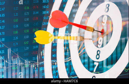 Arrows on dart board with stock market graph background mean the goal and success. Suitable for all artwork design - Stock Photo