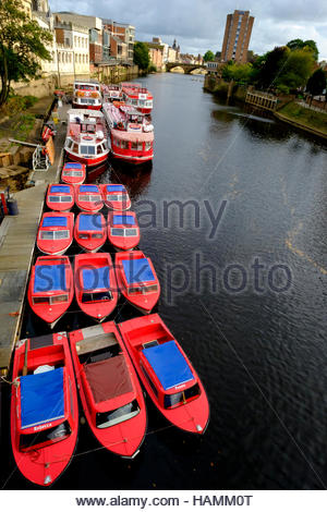 Red boats on the River Ouse York North Yorkshire England UK - Stock Photo