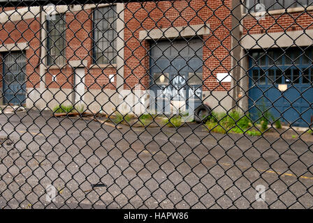 Chain link fence and no parking - Stock Photo