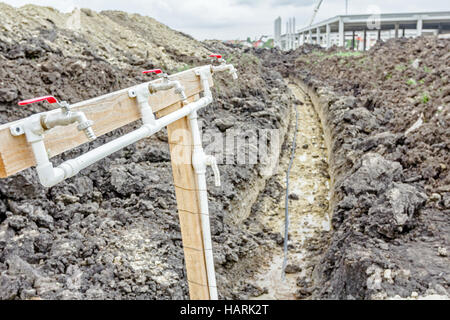 Several faucets with fresh water are placed temporarily at construction site for washing worker's hands. - Stock Photo