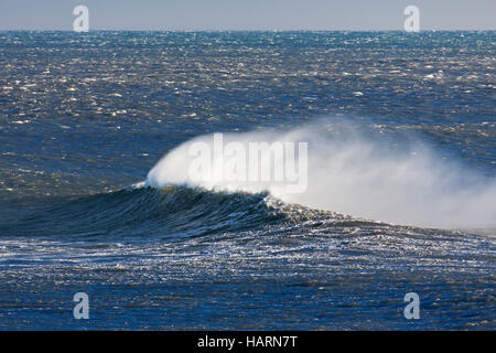 Wave crest at Arctic sea showing airborne spray and spindrift due to high winds - Stock Photo