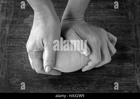Woman hands kneading dough. Food background and texture. copy space (BW) - Stock Photo
