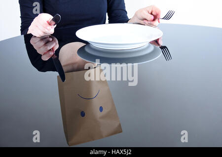 Reflection of Anonymou sad woman with empty plat sit at the table alone. Single woman lifestyle, sadness concept. - Stock Photo