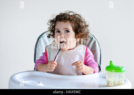 Little toddler child (girl age 2-3) waits for meal time. Childhood and children health care concept. Real people - Stock Photo