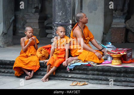 Young Buddhist monks at Angkor Wat Temple in Siem Reap, Cambodia - Stock Photo