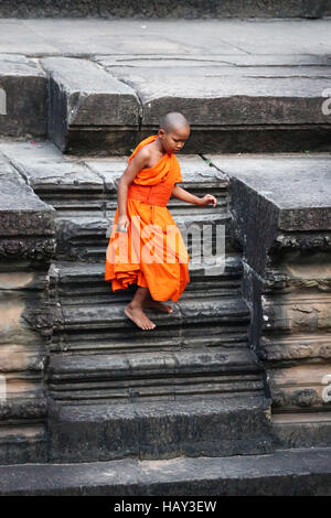 Young Buddhist monk at Angkor Wat Temple in Siem Reap, Cambodia - Stock Photo