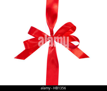 Red vertical gift ribbons and luxurious bow isolated on white background - Stock Photo