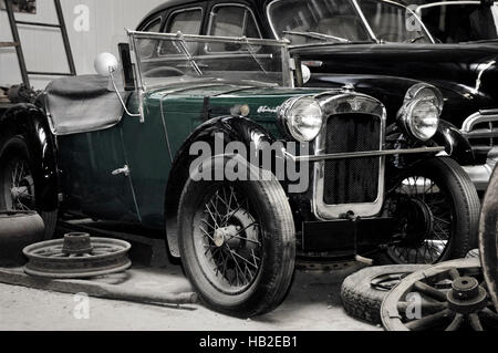 Green Austin Seven chummy open tourer, small British vintage car year 1929 - Stock Photo