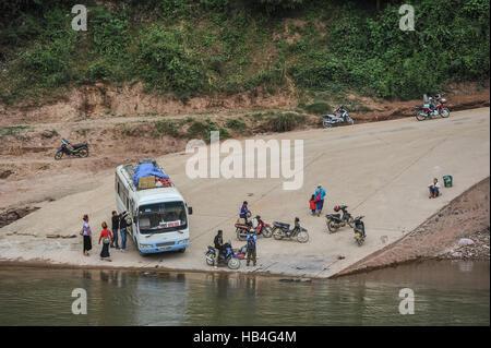 Crossing the river in Muang Khua, Laos - Stock Photo