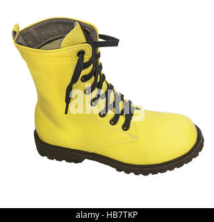 One high yellow boots with black laces - Stock Photo