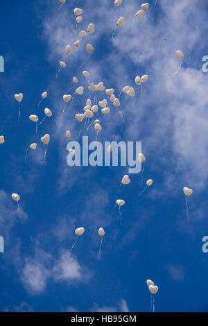 Heart Balloons Flying in Sky - Stock Photo
