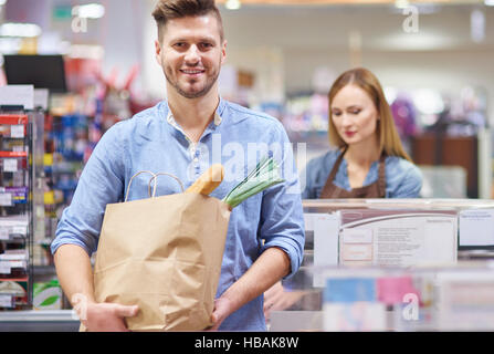 The young man finished his shopping - Stock Photo