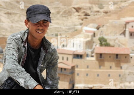 A young Bedouin boy near The Holy Lavra of Saint Sabbas the Sanctified, known in Arabic as Mar Saba, a Greek Orthodox - Stock Photo