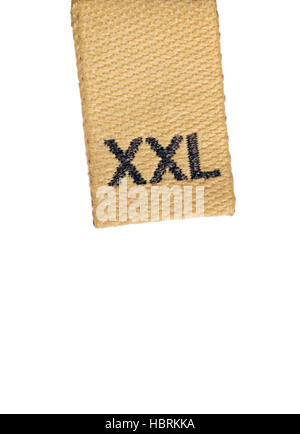 XXL size clothing label tag, beige brown, isolated macro closeup - Stock Photo
