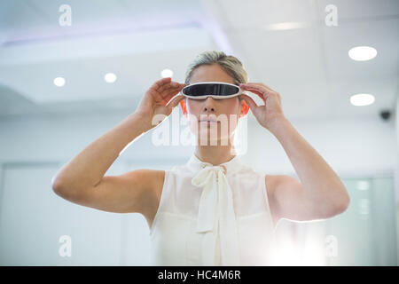 Woman using 3d video glasses - Stock Photo