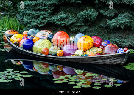 'Float Boat' glass sculpture, by Dale Chihuly, Monet Pool, Denver Botanic Gardens, Denver, Colorado USA - Stock Photo