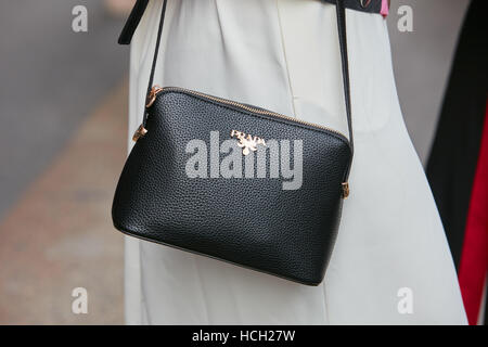 Woman with black leather Prada bag before Max Mara fashion show, Milan Fashion Week street style on September 22, - Stock Photo