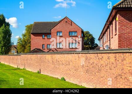 English red brick block of flats - Stock Photo