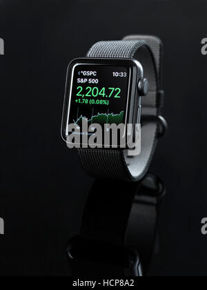 Apple Watch, smartwatch with stock market app displayed, black background - Stock Photo
