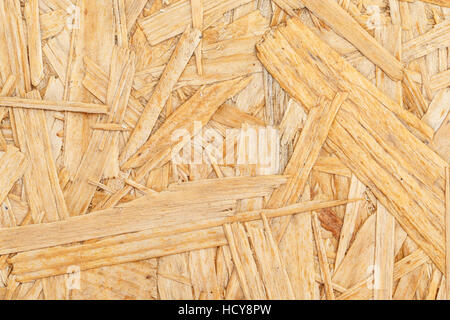 Chipboard. Close up pressed wooden panel background, OSB wood - Stock Photo