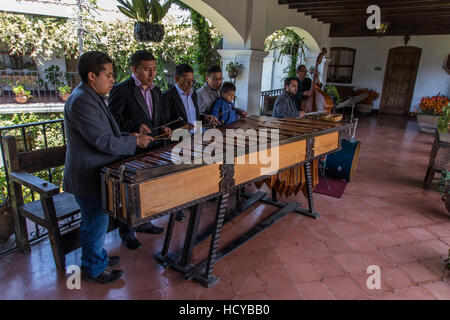 A marimba band performs traditional music at the Hotel Santo Tomás in Chichicastenango.  The marimba is the traditional - Stock Photo