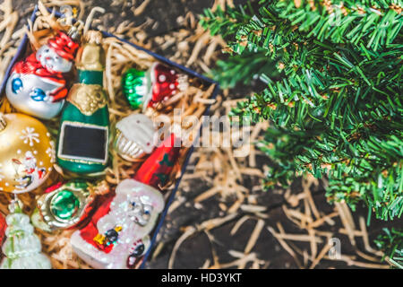 Box with vintage glass Christmas decorations view from above with space for text. - Stock Photo