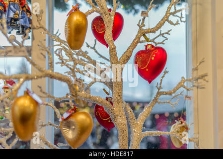 Hand-made glass decorations in a typical Christmas market in Switzerland - 1 - Stock Photo