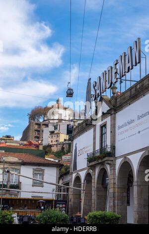 Cable car above Sandeman Port lodge, Vila Nova de Gaia, River Douro, Porto, Portugal - Stock Photo