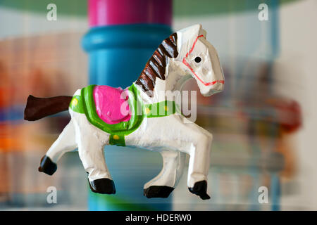 merry-go-round horse carillon, wooden carouse - Stock Photo